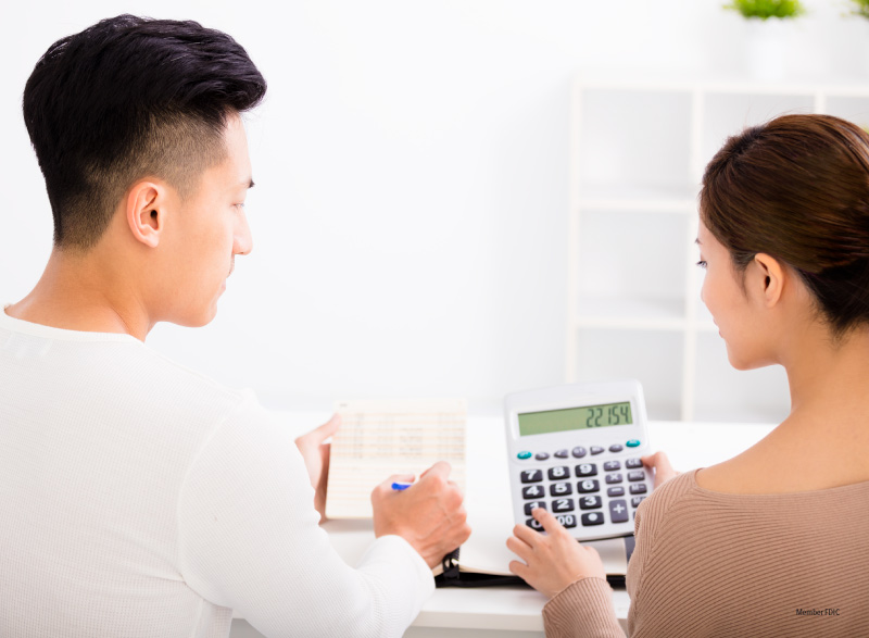 A young couple discussing their finances
